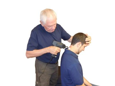 A health care professional using the Multiple Digital Toggle (MDT) on the neck of a patient